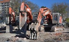 förstörelsegrävaregrävskopan machines mass Arkivbilder