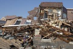 Förstört strandhus i efterdyningen av orkanen som är sandig i avlägsna Rockaway, New York Royaltyfri Fotografi