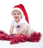 Första jul av en behandla som ett barnpojke Arkivfoto