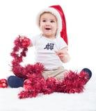 Första jul av ett lyckligt behandla som ett barn pojken Arkivbild