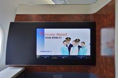 Första klasskabinen av ett Korean Airlines KE Boeing 747-8 flygplan Royaltyfri Fotografi