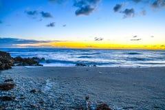 Första ljus på en Florida strandbakgrund Arkivfoton