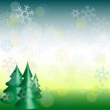 Första snöfallbakgrund på ferie tre sörjer träd Royaltyfria Bilder