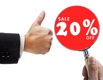 Förstoringsglas och försäljning 20% Arkivfoton
