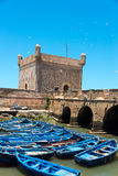 Förtöjde fisherboats i essaouiraport Fotografering för Bildbyråer