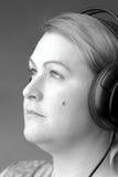 förteckningsmusik till kvinnan royaltyfria bilder