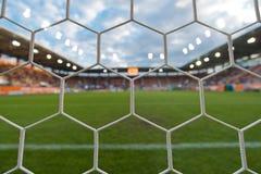 Förtjäna av fotbollmål Arkivfoto