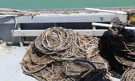 förtjäna i ett fartyg som väntar för att ta av till att fiska Royaltyfri Fotografi