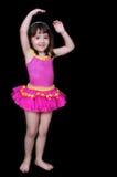 förtjusande flicka isolerad liten pink tu Royaltyfri Fotografi