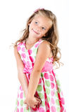 Förtjusande le liten flicka i prinsessaklänningiso Arkivbilder
