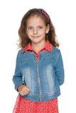 Förtjusande liten flicka mot viten Fotografering för Bildbyråer