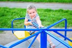 Förtjusande liten flicka på karusell Royaltyfri Fotografi