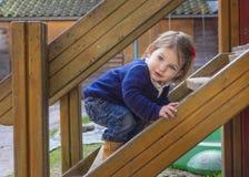 Förtjusande liten flicka på lekplatsen Royaltyfria Bilder