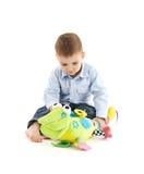Förtjusande litet barn med den gulliga mjuka toyen Royaltyfria Bilder