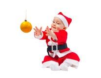 Förtjusande pojke i dräkten av Santa Claus Royaltyfri Bild