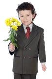 förtjusande pojkeblommor Royaltyfri Fotografi