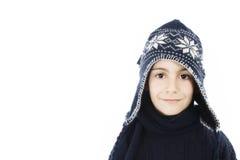 förtjusande pojkeklädervinter Arkivbild