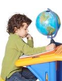 förtjusande pojkewriting royaltyfri fotografi