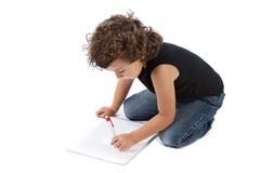 förtjusande pojkewriting arkivfoto