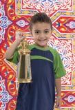 Förtjusande ung pojke med Ramadan Lantern Arkivfoton