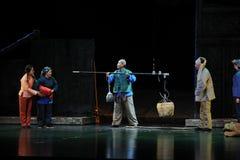 Förvärvet av råvaror -- Jiangxi opera en besman Arkivfoto