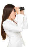 Förvånad affärskvinna Looking Through Binoculars Arkivbild