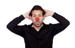 Förvånad affärsman med clownnäsan Arkivfoto