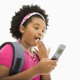 förvånad flickatelefon Royaltyfria Bilder