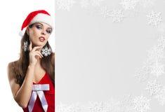 Förvånad julkvinna i santa Royaltyfria Bilder