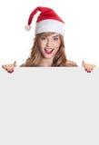 Förvånad julkvinna som slitage en santa hatt Fotografering för Bildbyråer