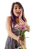 förvånad kvinna för blommor Royaltyfri Bild