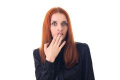 Förvånad kvinna och att täcka hennes mun med handen Arkivbilder