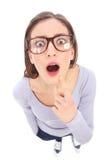 Förvånad kvinnlig nerd arkivfoton