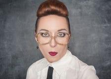 Förvånad lärare Arkivfoto