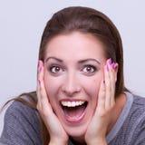 Förvånad ung härlig flicka Fotografering för Bildbyråer