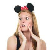 Förvånad ung kvinna med musöron Arkivbilder