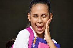 Förvånad ungdomlig colombiansk skolaflicka Arkivfoton