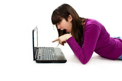 förvånat peka för flickabärbar dator Royaltyfri Fotografi
