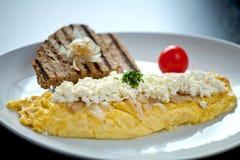 Förvanskad äggfrukost Arkivbild