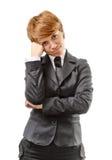 Förvirrad affärskvinna på en vit Arkivfoto