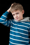 Förvirrad ung pojke Royaltyfri Bild