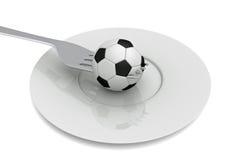 Fútbol como comida: fútbol, bifurcación y placa Imagen de archivo libre de regalías