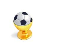Fútbol como comida: fútbol en una huevera de oro Imagenes de archivo