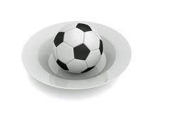 Fútbol como comida: fútbol en una placa profunda Imágenes de archivo libres de regalías