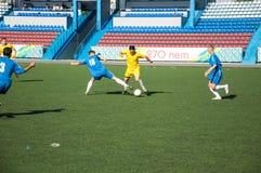 Fútbol del juego de los muchachos Foto de archivo libre de regalías