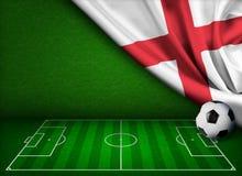 Fútbol o campo de fútbol con la bandera de Inglaterra Imágenes de archivo libres de regalías