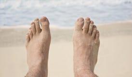 Füße auf Strand Stockfotos