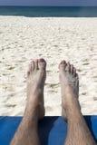 Füße auf Strand Stockfoto