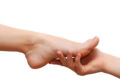 Füße des Mannes Hand- und der Frau Lizenzfreies Stockbild
