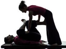 Füße siamesisches Massage-Schattenbild der Fahrwerkbeine Lizenzfreies Stockfoto